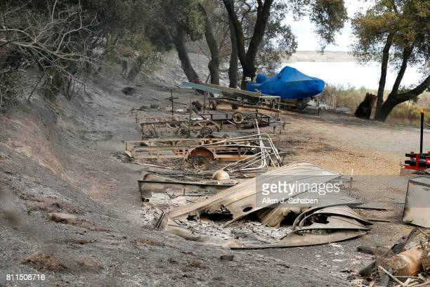 The remains of a structure and boats scorched by the Whittier Fire along SR154 in the Los Padres National Forest near Lake Cachuma Santa Barbara...