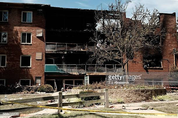 The remains of a structure are seen after an overnight explosion and fire destroyed an apartment building in the Flower Branch Apartments complex on...