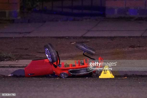 The remains of a toy car is marked by police accident markers after two brothers aged six and two died after a suspected hitandrun crash on February...