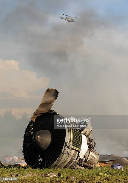 The remains of a turbine remain amid the smoldering wreckage of an aircraft that crashed in Mosquera Cundinamarca department Colombia on July 7 2008...