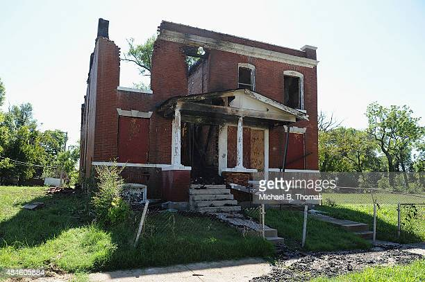 The remains of a uninhabited house that was set ablaze by protestors is seen on August 20 2015 in St Louis Missouri Protests erupted on August 19...