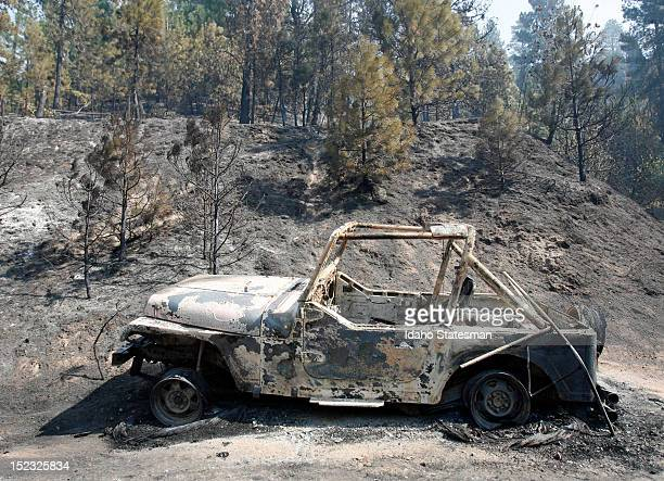 The remains of a vehicle at a home on Tuesday September 18 that fell victim as the Karney Fire burned through Boise County Idaho