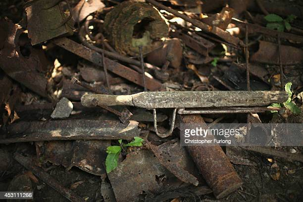 The remains of a World War One stretcher sits amongst recovered artefacts at the preserved 'Sanctuary Wood' on August 3 2014 in Ypres Belgium Monday...