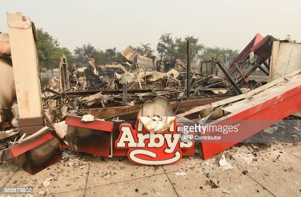 The remains of an Arby's restaurant is seen after burning down in Santa Rosa California on October 10 2017 Firefighters encouraged by weakening winds...