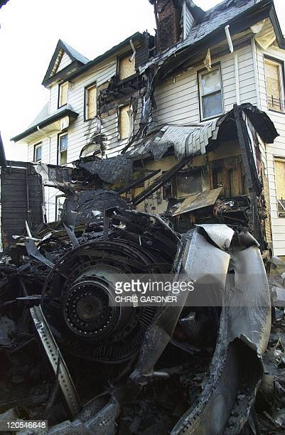 The remains of an engine from American Airlines Flight 587 is shown in the backyard of 414 B128th Street, 13 November in the Belle Harbor...