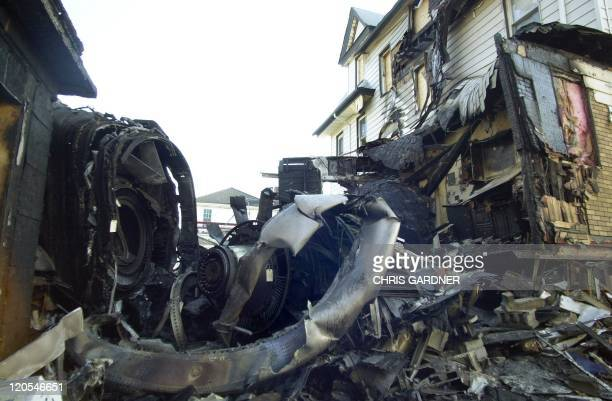 The remains of an engine from American Airlines Flight 587 is shown in the backyard of 414 B128th Street 13 November in the Belle Harbor neighborhood...
