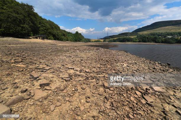 The remains of an old building predating the reservoir are seen on the driedout reservoir bed due to low water levels in Bottoms Reservoir one of the...