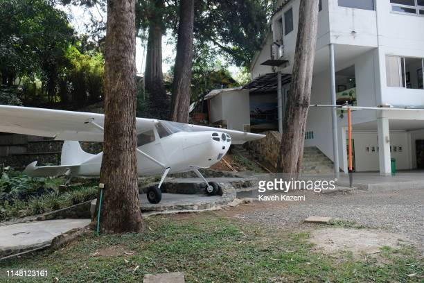 The remains of an old Cessna airplane which was used by Pablo Escobar to bring drug money from Panama is displayed in the courtyard of his family...