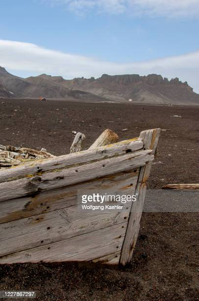 The remains of an old whaling boat on the black lave beach of Whaler's Bay, inside Port Foster, a caldera on Deception Island, an island in the South...