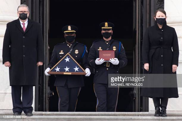 The remains of Capitol Police Officer Brian Sicknick are carried down the East Front steps after 'lying in honor' in the Rotunda of the US Capitol in...