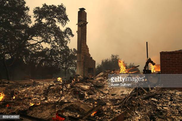 The remains of fire damaged homes after an out of control wildfire moved through the area on October 9 2017 in Glen Ellen California Tens of...