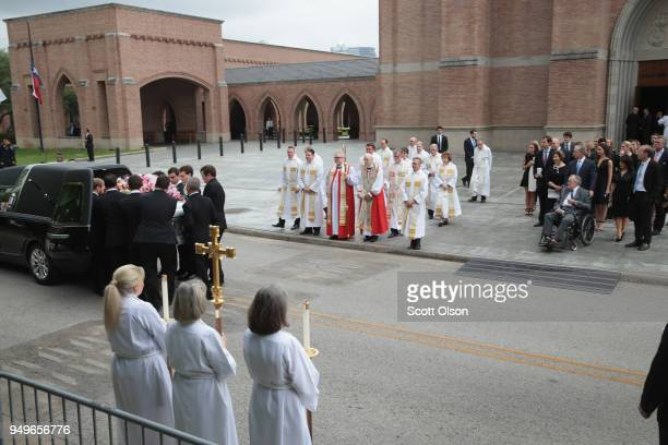 The remains of former first lady Barbara Bush are carried from St Martin's Episcopal Church following her funeral service on April 21 2018 in Houston...