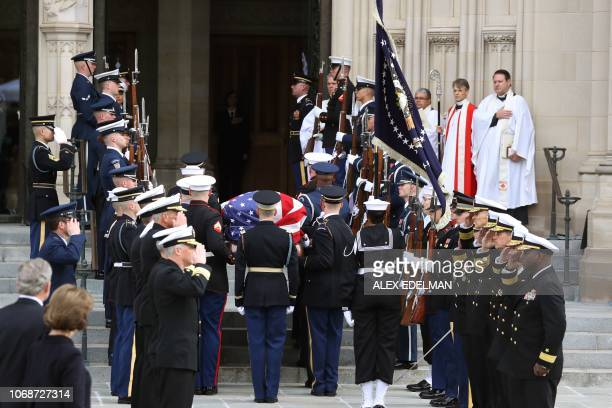 TOPSHOT The remains of former US President George H W Bush arrive at the National Cathedral in Washington DC for a funeral service on December 5 2018