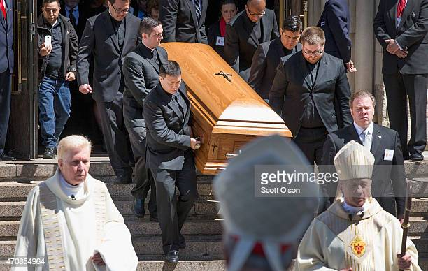 The remains of Francis Cardinal George eighth Archbishop of Chicago are carried from Holy Name Cathedral following his funeral service on April 23...