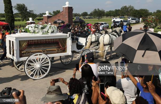 The remains of George Floyd are brought by horsedrawn carriage in a funeral procession into Houston Memorial Gardens Cemetery for burial on June 9...