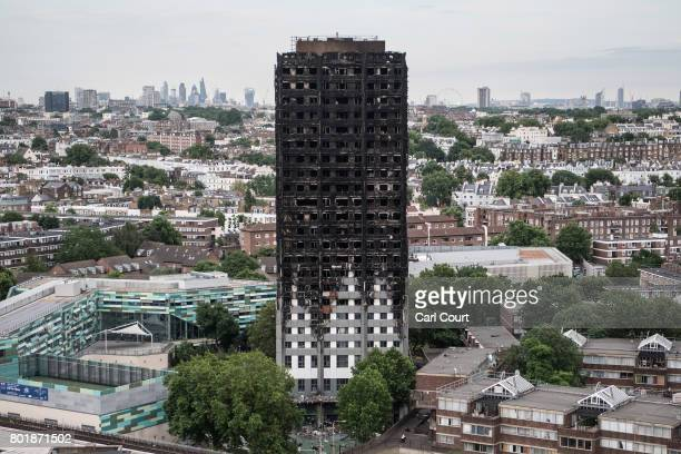 The remains of Grenfell Tower are seen from a neighbouring tower block on June 26 2017 in London England 79 people have been confirmed dead and...