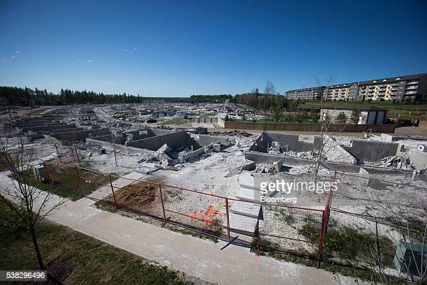 The remains of houses destroyed by wildfire are seen in the Timberlea neighborhood of Fort McMurray Alberta Canada on Sunday June 5 2016 Residents...