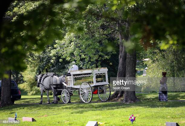 The remains of Michael Brown arrive at Saint Peters Cemetery for burial on August 25 2014 in St Louis Missouri Michael Brown an 18 yearold unarmed...