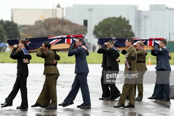 The remains of New Zealand Defence Force personnel repatriated from Malaysia and Singapore arrive at Auckland International Airport on August 21 2018...