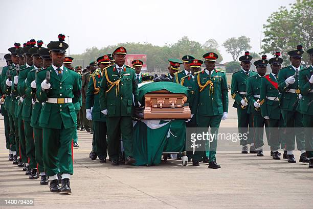 The remains of Nigeria's secessionist leader Odumegwu Ojukwu receive last respect after arrival at the Presidential Wing of Inamdi Azikiwe...