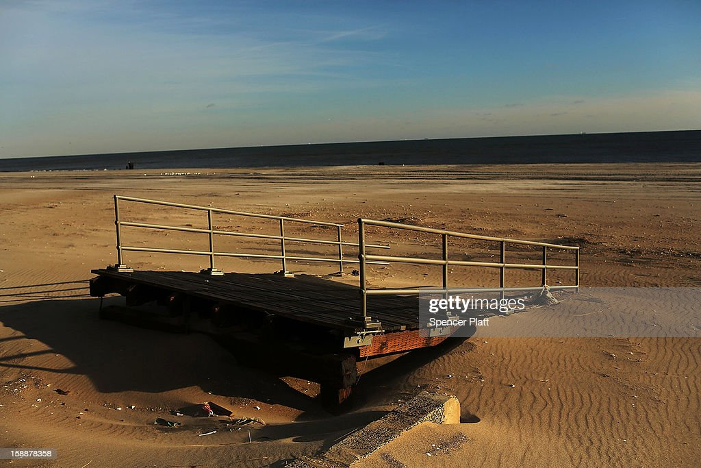 The remains of part of the boardwalk lie along the beach in the Rockaways on January 2, 2013 in the Queens borough of New York City. Criticism, including by President Barack Obama, has been directed at the Republican House's decision to adjourn without passing a Superstorm Sandy aid bill. According to early estimates, Superstorm Sandy inflicted at least $50 to $60 billion in damage across the Northeast, making it one of the most destructive storms ever.