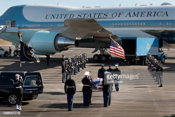 The remains of President George HW Bush are carried to Special Air Mission 41 by a military honor guard before flying to Washington D C on December 3...