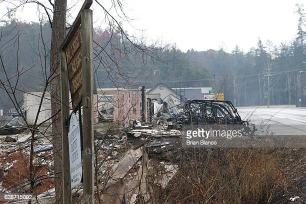 The remains of several businesses smolder in the wake of a wildfire November 30 2016 in Gatlinburg Tennessee Thousands of people have been evacuated...