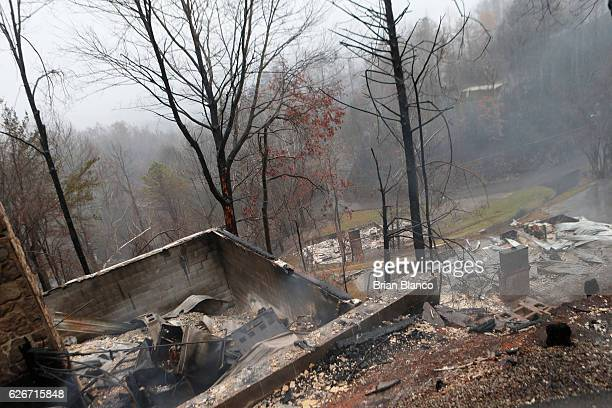The remains of several homes smolder in the wake of a wildfire November 30 2016 in Gatlinburg Tennessee Thousands of people have been evacuated from...