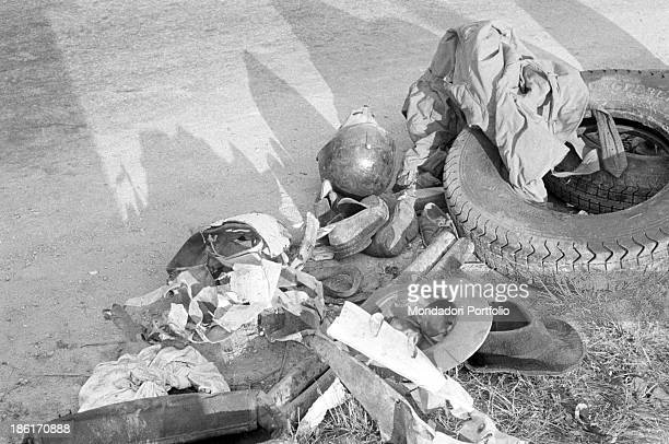 The remains of the accident at the Mille Miglia Automobile Race Spanish racing driver Alfonso de Portago American navigator Edmund Gurner Nelson and...