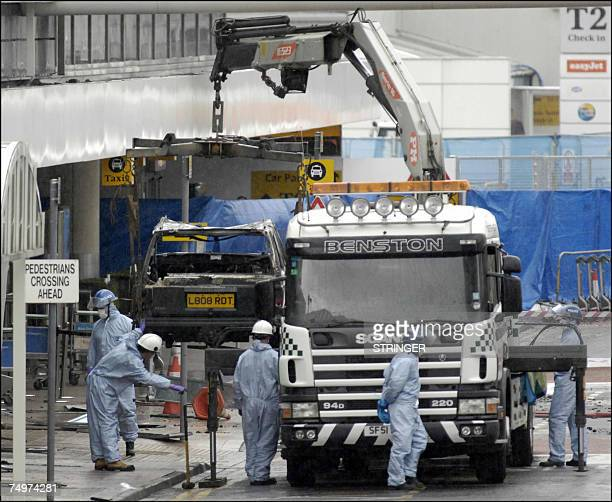 The remain's of the burnt out jeep is lifted by police forensics officers from the scene at Glasgow International Airport 01 July 2007 where a Jeep...