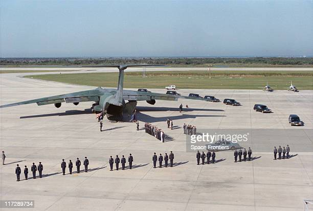 The remains of the crew of the space shuttle 'Challenger' are moved from the Shuttle Landing Facility at the Kennedy Space Center on Merritt Island...
