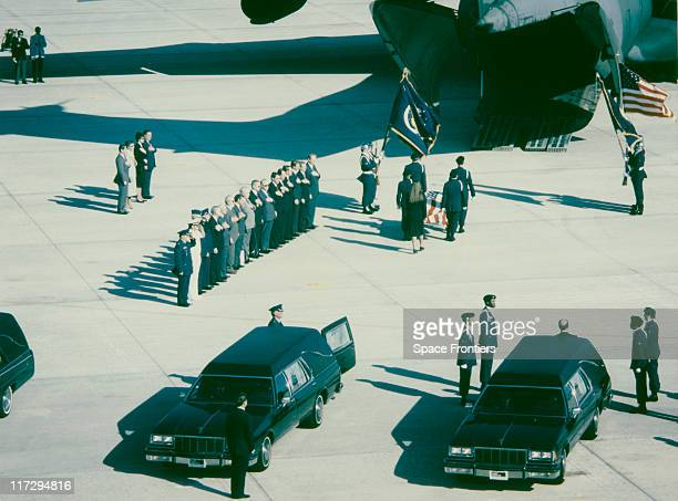 The remains of the crew of the Space Shuttle Challenger are transferred to a C141 transport plane at the NASA KSC Shuttle Landing Facility bound for...
