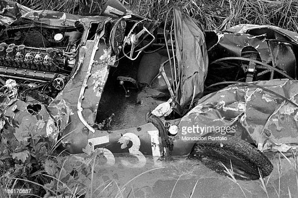 The remains of the Ferrari destroyed during the Mille Miglia Automobile Race Spanish racing driver Alfonso de Portago American navigator Edmund...