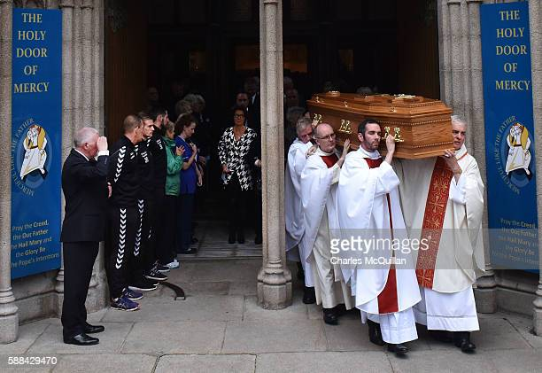 The remains of the late retired Bishop of Derry Dr Edward Daly are carried from St Eugene's Cathedral after requiem mass on August 11 2016 in...