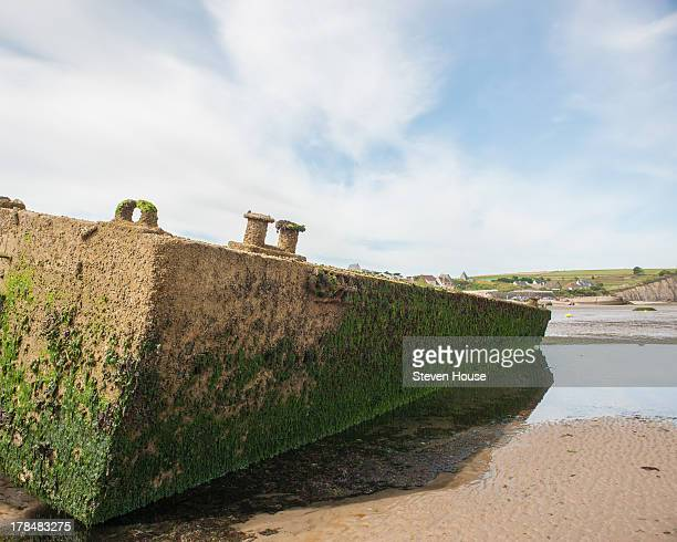 CONTENT] The remains of the World War II Mulberry Harbour at Arromanche Normandy France These floating harbours were used during 'D' Day 5th June...