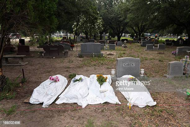 The remains of unidentified immigrants lie in a cemetery after being exhumed on May 21 2013 in Falfurrias Texas Teams from Baylor University and the...