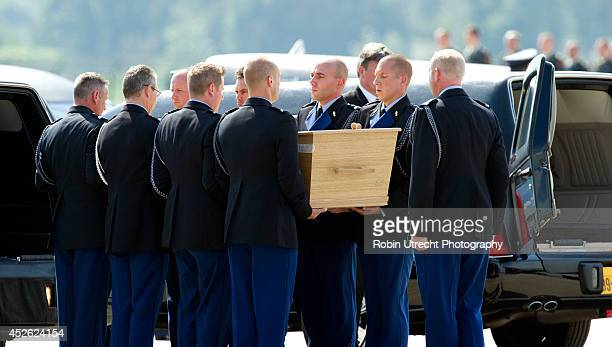 The remains of victims of Malaysia Airlines flight MH17 arrive at Eindhoven Airport July 24 2014 in Eindhoven the Netherlands Seventy more bodies...