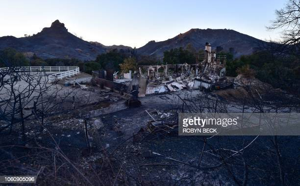 TOPSHOT The remnants of a home destroyed in the Woolsey fire are seen November 12 2018 along Mulholland Highway in the hills above Malibu California...