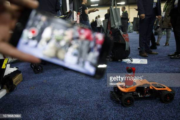 The Remo Technology Co Obsbot Tail artificial intelligent camera sits on a remote controlled vehicle during a demonstration at the CES Unveiled event...