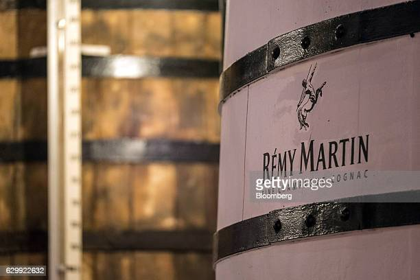 The Remy Martin logo sits on a barrel of fine champagne cognac inside the Francis cellar at the Remy Cointreau SA headquarters in Cognac France on...