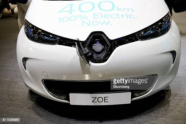 The Renault badge sits on an open electric charging socket cover of a new battery-powered Zoe city car, manufactured by Renault SA, during the second...