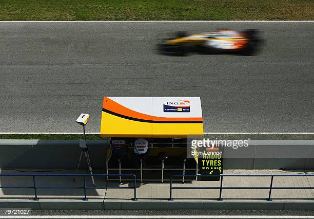 The Renault R28 passes the pit wall during Formula One Testing at the Circuito de Jerez on February 12 2008 in Jerez Spain