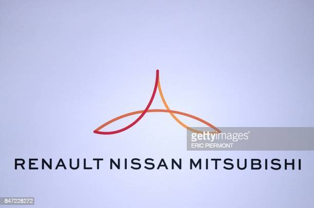 The RenaultNissanMitsubishi logo is displayed during a press conference in Paris on September 15 to present the Renault Nissan group strategy / AFP...