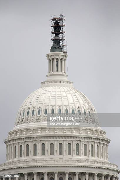 The renovation of the statue on top of the US Capitol dome in Washington DC on April 23 2012 A scaffold surrounds the statue of Freedom as it gets a...