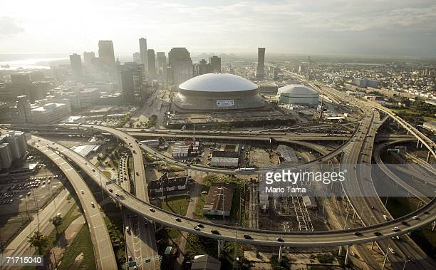 The repaired Louisiana Superdome sits near the city skyline are seen August 25 2006 in New Orleans Louisiana The first anniversary of Hurricane...