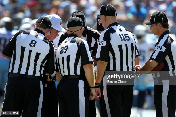 The replacement officials gather for an on the field discussion after a play in the second quarter of the New England Patriots season opener against...