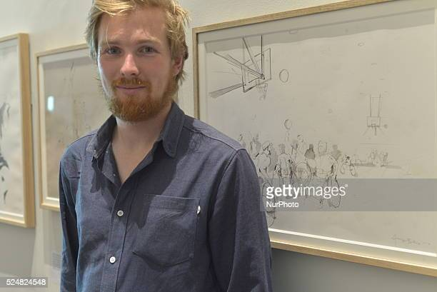 The reportage illustrator standing in his exhibition at the Imperial War Museum in Salford Greater Manchester England on Sunday 23rd August 2015...