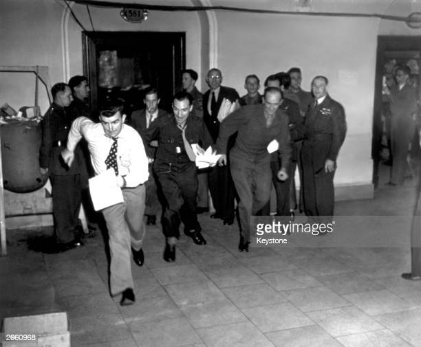 The reporters dash away with the news of the sentences passed at the conclusion of the 'greatest trial in history' at the Palace of Justice Nuremberg