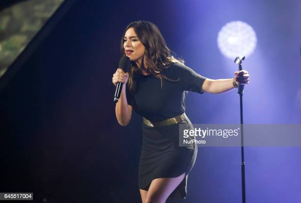 The representative of France to the Eurovision Song Contest Alma performs on a stage as a guestduring the final of the Ukrainian national...