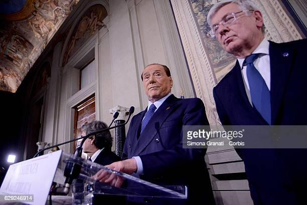 The Representative of the 'Forza Italia' Party Silvio Berlusconi Renato Brunetta and Paolo Roma speak to the media after leaving the President Sergio...